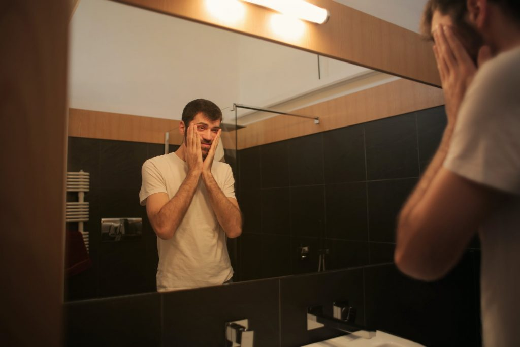 Man in mirror with OCD